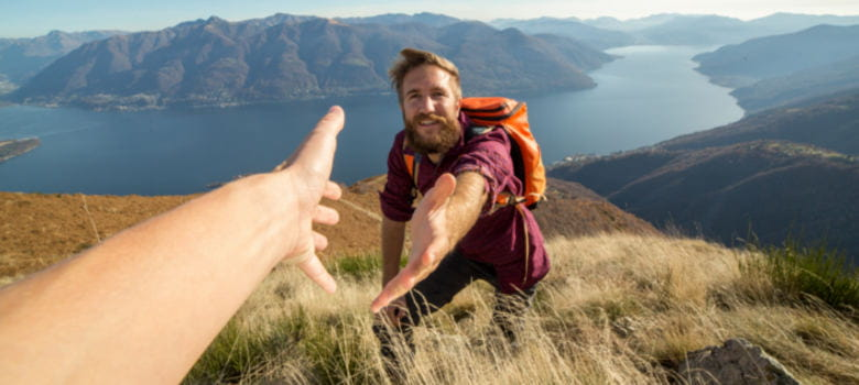 Hiker reaching out for help