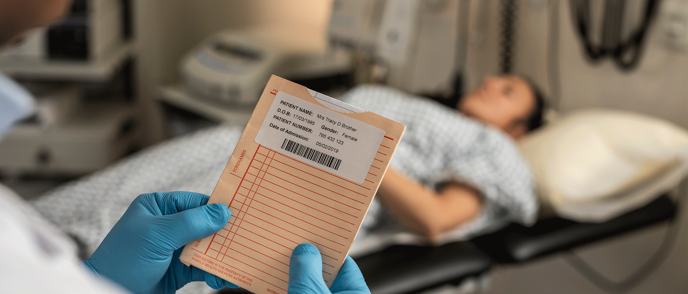 Lady on hospital bed with doctor checking files