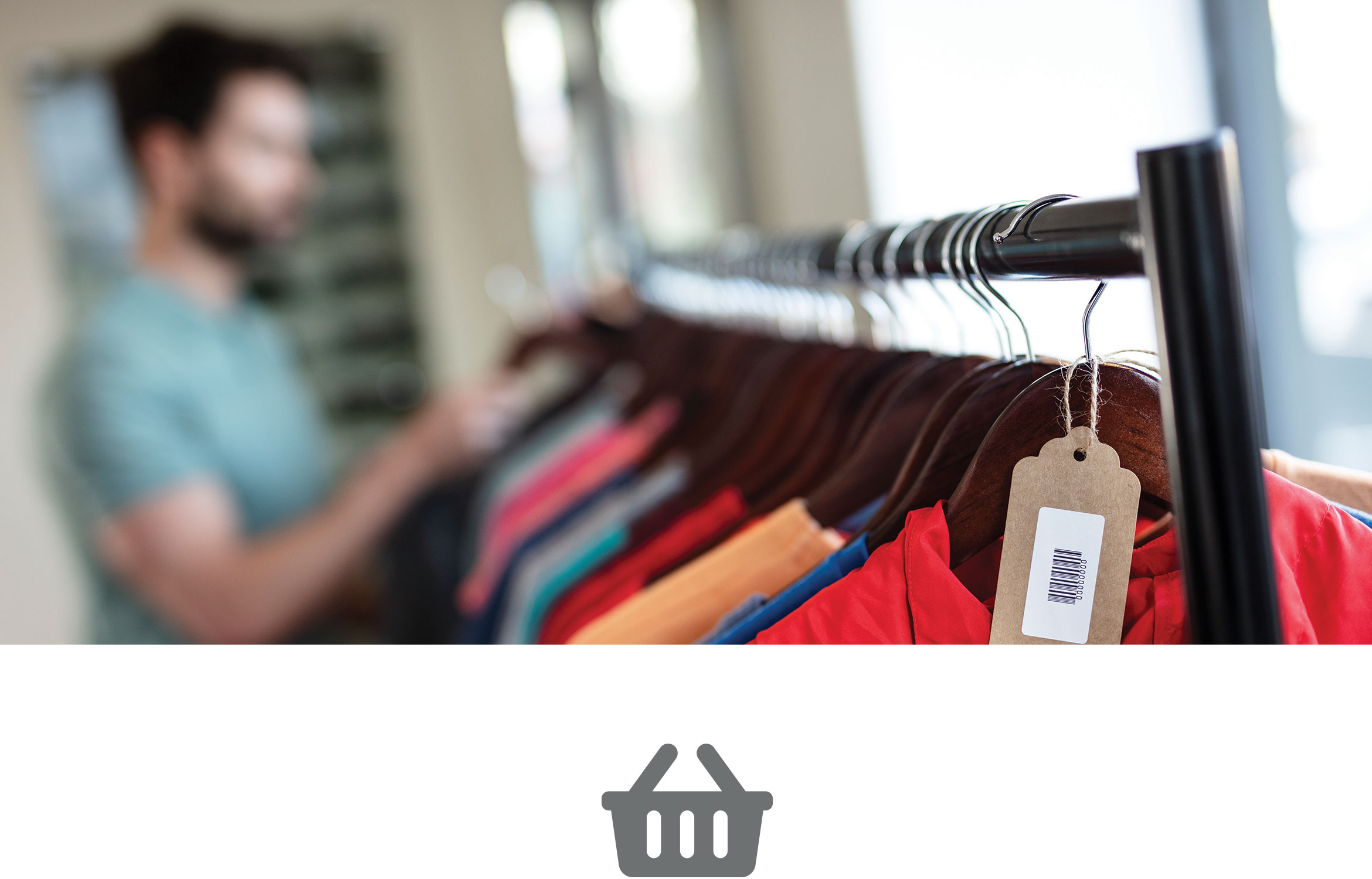 Man looking at rail of colourful tops in clothes store