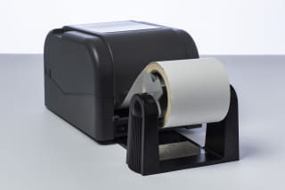 Brother PA-RH-001 external roll holder installed on a TD-4T series label printer