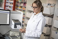 Lady doctor printing a label for medical files from a TD-4D series label printer