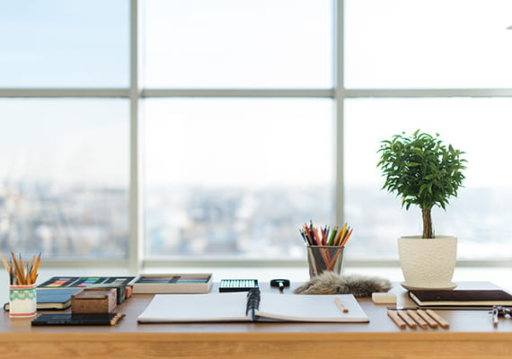 image of a desk with open notepad